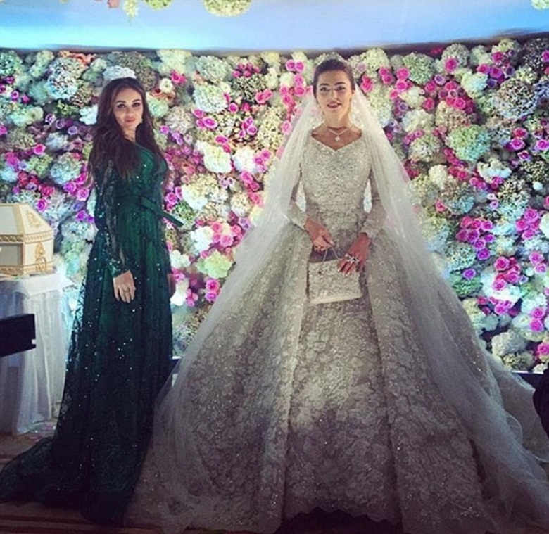 32A70CC300000578-3514779-Khadija_carried_a_handbag_to_match_her_Elie_Saab_couture_wedding-a-22_1459301110780
