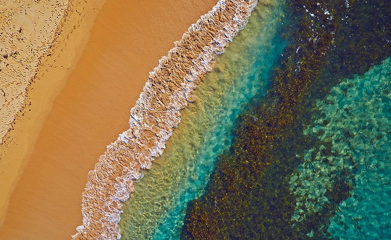 Water and sand mingle to create an ocean masterpiece – Manly Beach, Sydney, Australia.