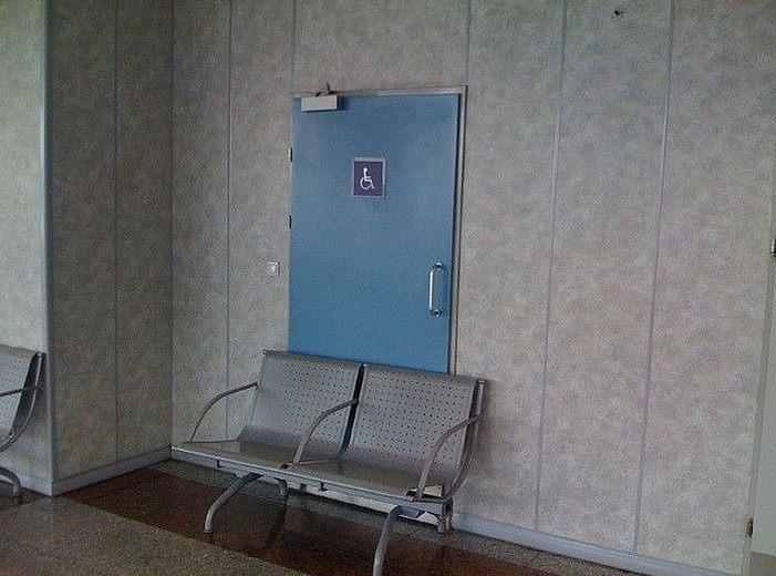 handicapped-access-door-blocked-by-bench